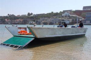 10.2m Aluminium Landing Craft, flat bottom and low draft capabilities, with the ramp extended on to shore